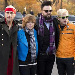 Members of the band Neon Trees, from left, Tyler Green, Elaine Bradley, Branden Campbell and Chris Allen arrive to the Macy's Thanksgiving Day Parade in New York, Nov. 22, 2012.