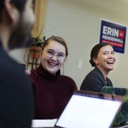 Salt Lake City mayor candidate Erin Mendenhall, right, laughs with campaign staff members Luigi Guadarrama and Gabby Romney during a meeting at her campaign headquarters in Salt Lake City on Thursday, Oct. 10, 2019.