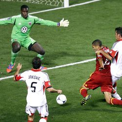 Alvaro Saborio of Real Salt Lake shoots at the goal under pressure from Dejan Jakovic, (5), goalkeeper Bill Hamid and Emiliano Dudar of DC United during their MLS matchup at Rio Tinto Stadium in Sandy Saturday, September 1, 2012