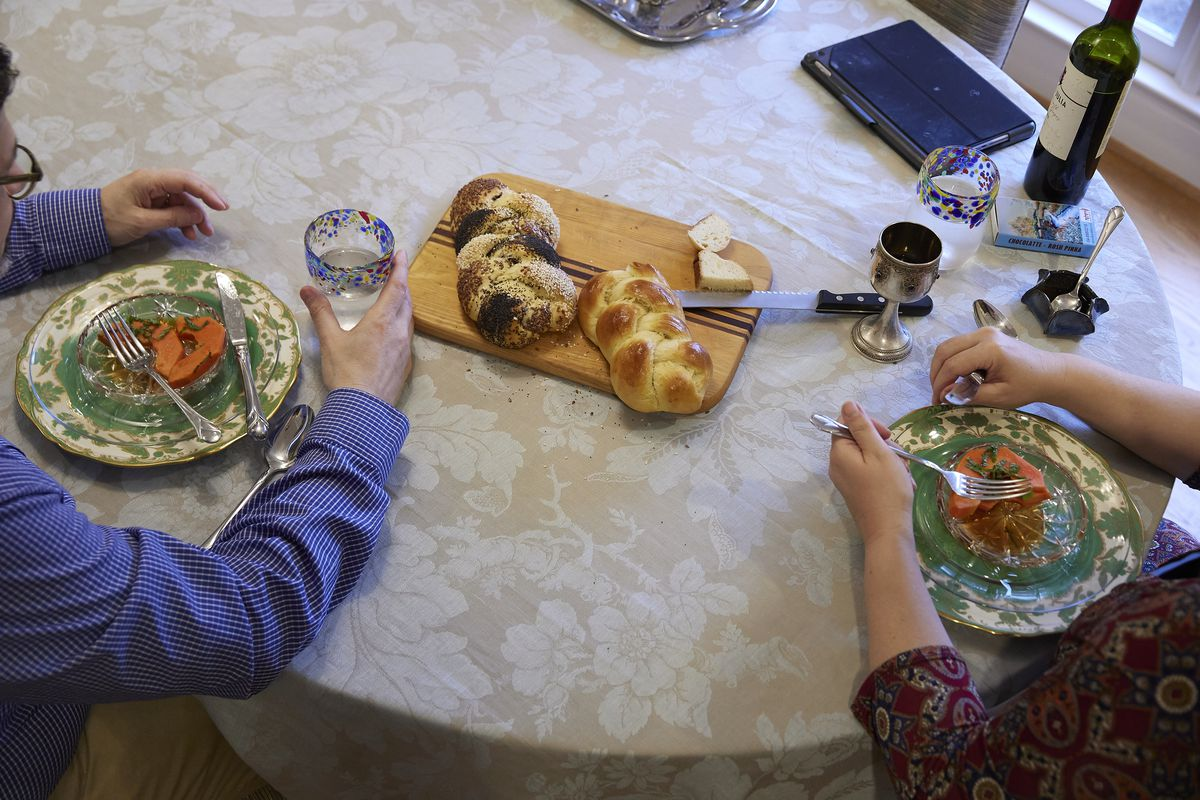 Rabbi Ruth Abusch-Magder and her husband, David Abusch-Magder, celebrate Shabbat on Friday evening at their home in Sandy Springs, GA.