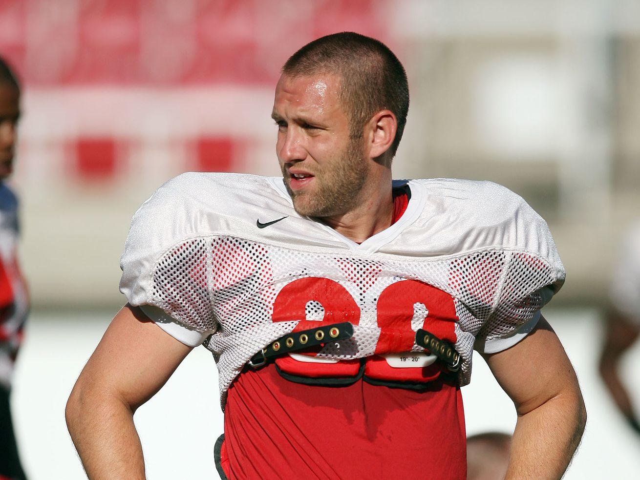 University of Utah football player Steve Tate rests during a scrimmage at Rice Stadium in Salt Lake City Aug 10, 2007.