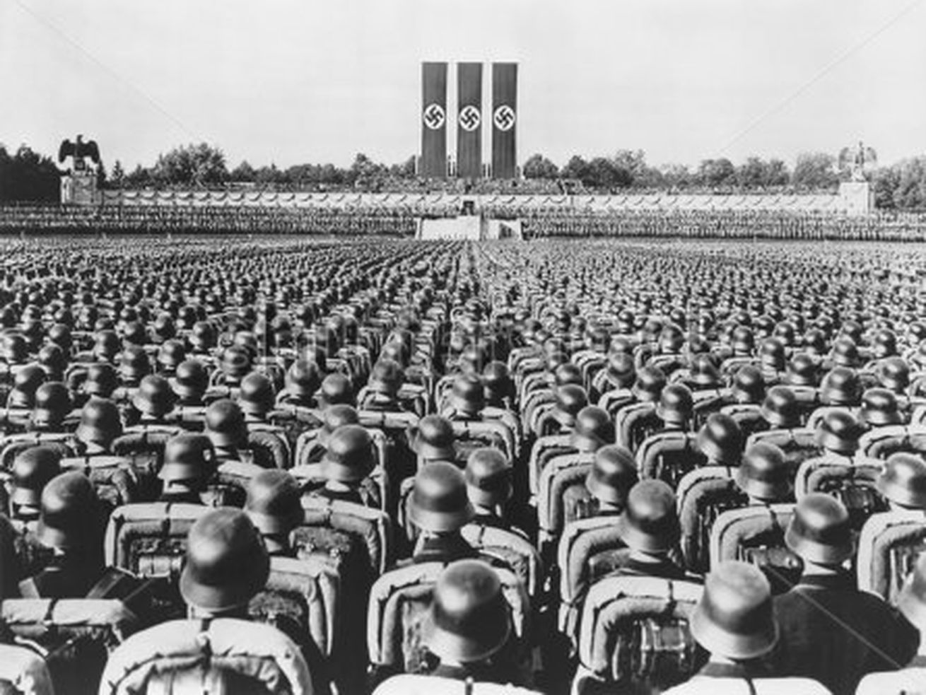 """Nearly 100,000 Nazi storm troopers are gathered to listen to a 1933 speech by Adolf Hitler on """"Brown Shirt Day."""""""