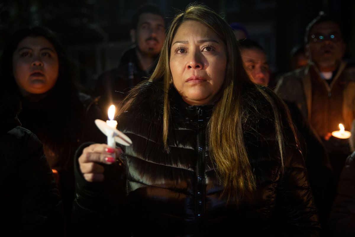 Carmen Cruz leads a vigil for her son, Erik Diaz, who was shot in the cheek by ICE agents.