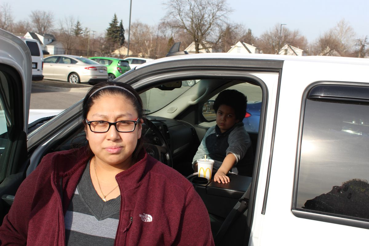 Michelle Villa stands in the parking lot of the Southwest Detroit Community School before a school board meeting last week.