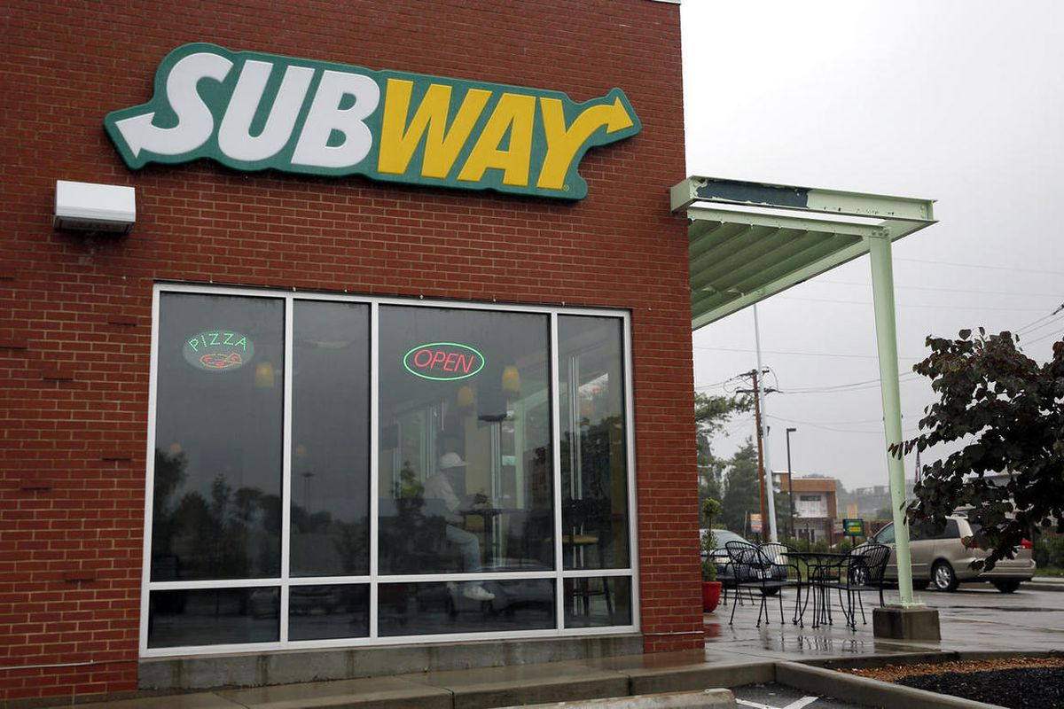 A Subway restaurant is shown Tuesday, July 7, 2015, in St. Louis. FBI agents and Indiana State Police raided the home of Subway restaurant spokesman Jared Fogle on Tuesday, removing electronics from the property and searching the house with a police dog.