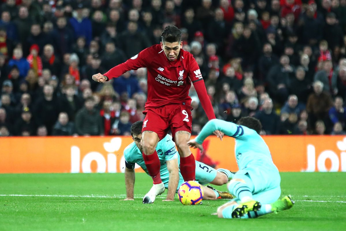 Roberto Firmino leaves the Arsenal defenders littered on the ground as he scores his second