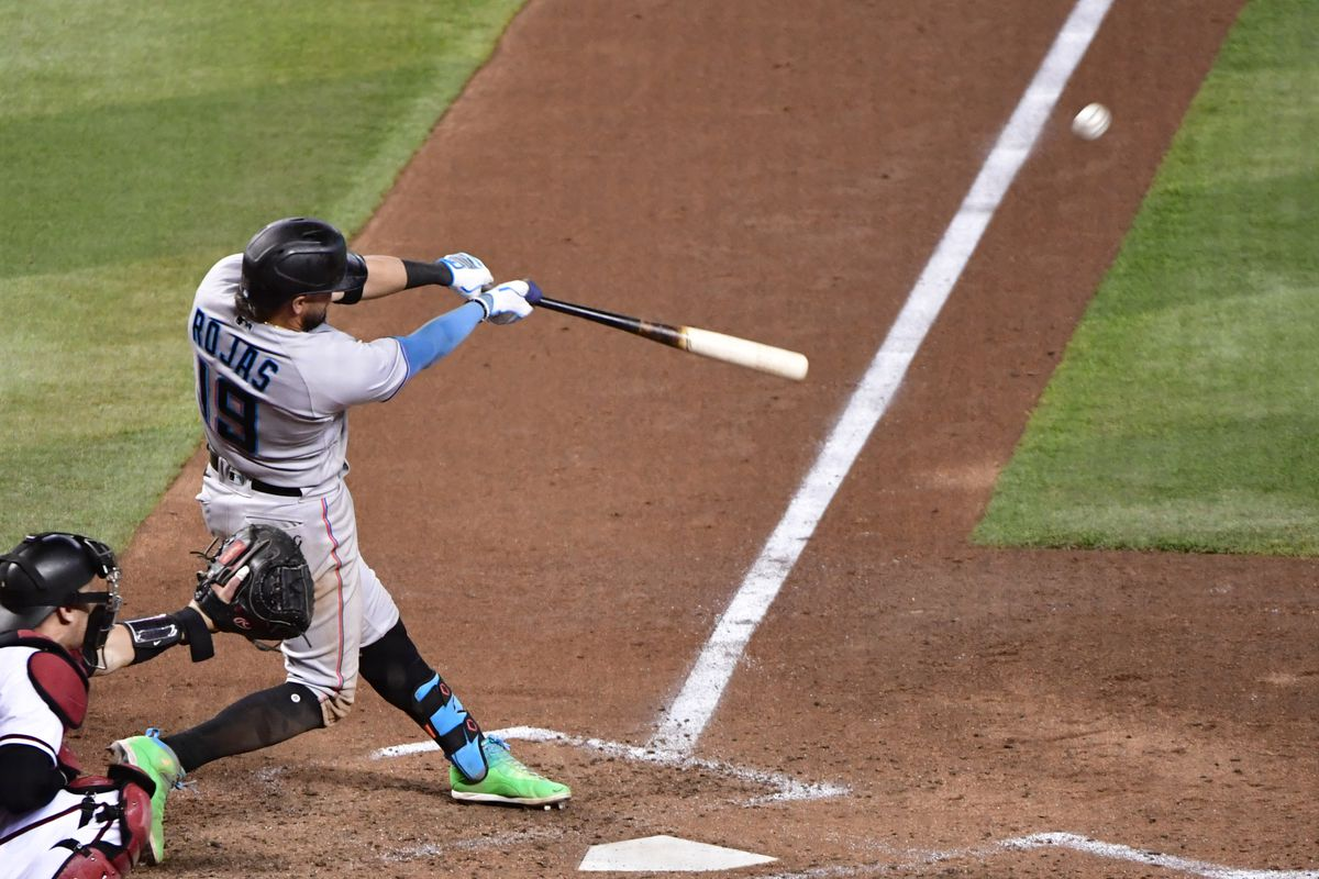 Miami Marlins shortstop Miguel Rojas (19) doubles during the seventh inning against the Arizona Diamondbacks at Chase Field.
