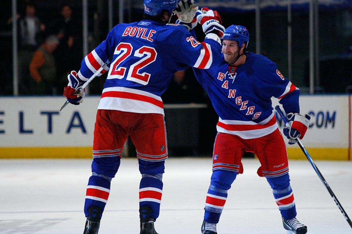 Wait, you got Henrik, I got Daniel? How can you tell them apart?!?! (Photo by Andy Marlin/Getty Images)