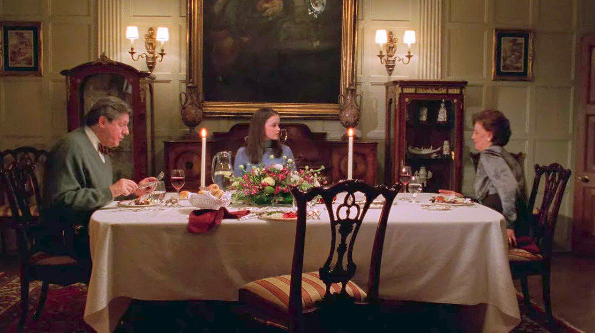 Rory, Richard, and Emily Gilmore sit in their formal dining room.