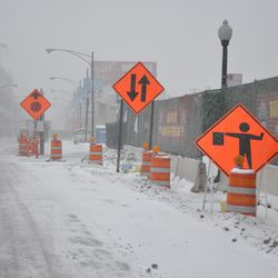 Looking north on Clark Street at the construction gate into the triangle lot