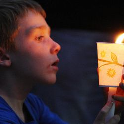 Kelton Sidwell, cousin to Sgt. Derek Johnson, holds candle during a vigil held in his honor   in Draper Sunday, Sept. 1, 2013. Johnson was shot and killed this morning.