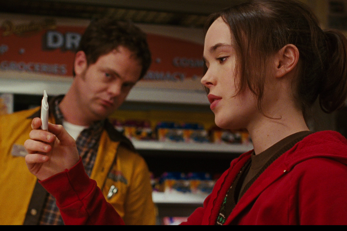 Juno, played by Ellen Page, looks at a pregnancy test in the 2007 film Juno.