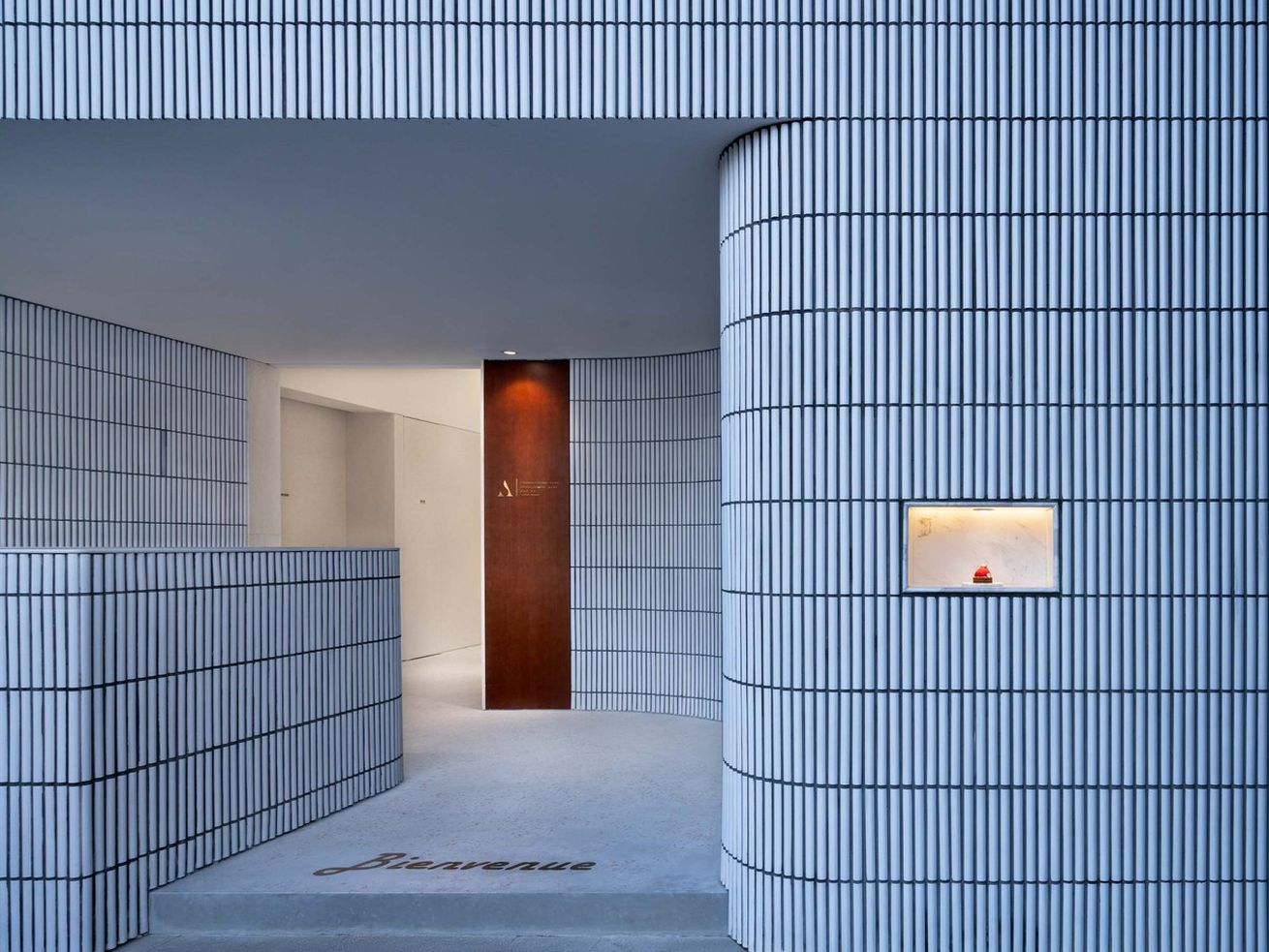 Minimalist pastry shop lures you in with curved tile facade