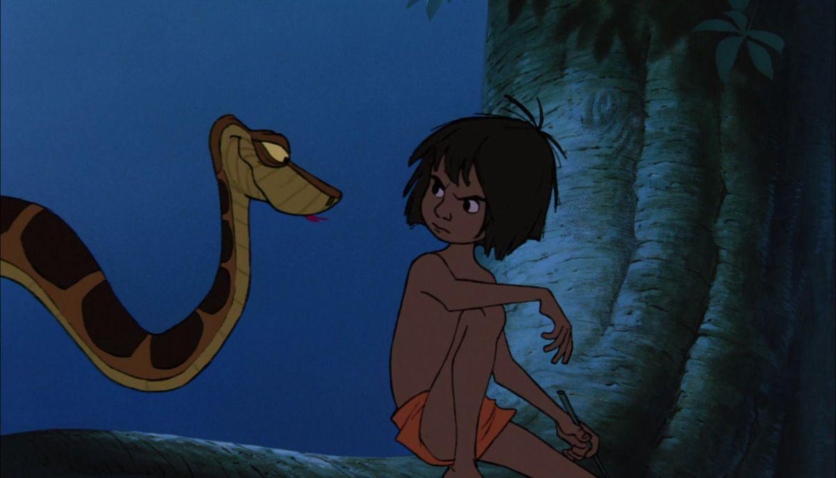 mowgli scowls at raa the snake