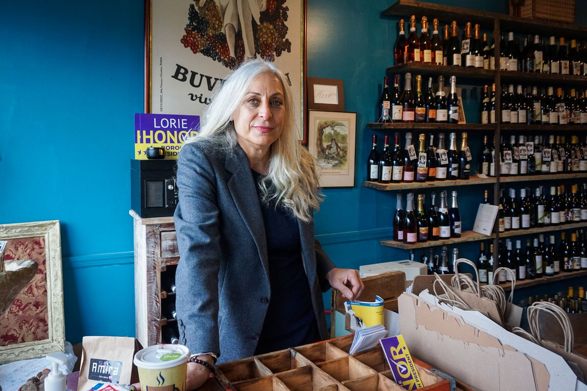 Lorie Honor, a Democrat running on Staten Island, stands in her Stapleton wine shop on Wednesday.