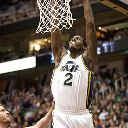 Jazz forward Marvin Williams (2) slam dunks the ball during the first half of the NBA basketball game between the Utah Jazz and the Golden State Warriors at Energy Solutions Arena, Wednesday, Dec. 26, 2012.