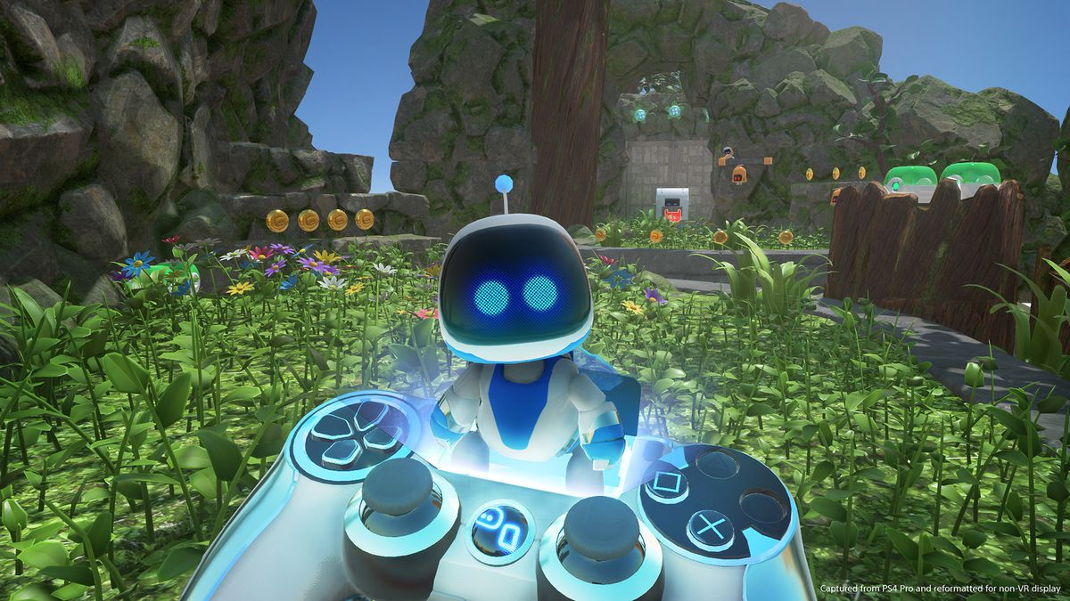 holding a controller in front of a robot in a field in Astro Bot Rescue Mission
