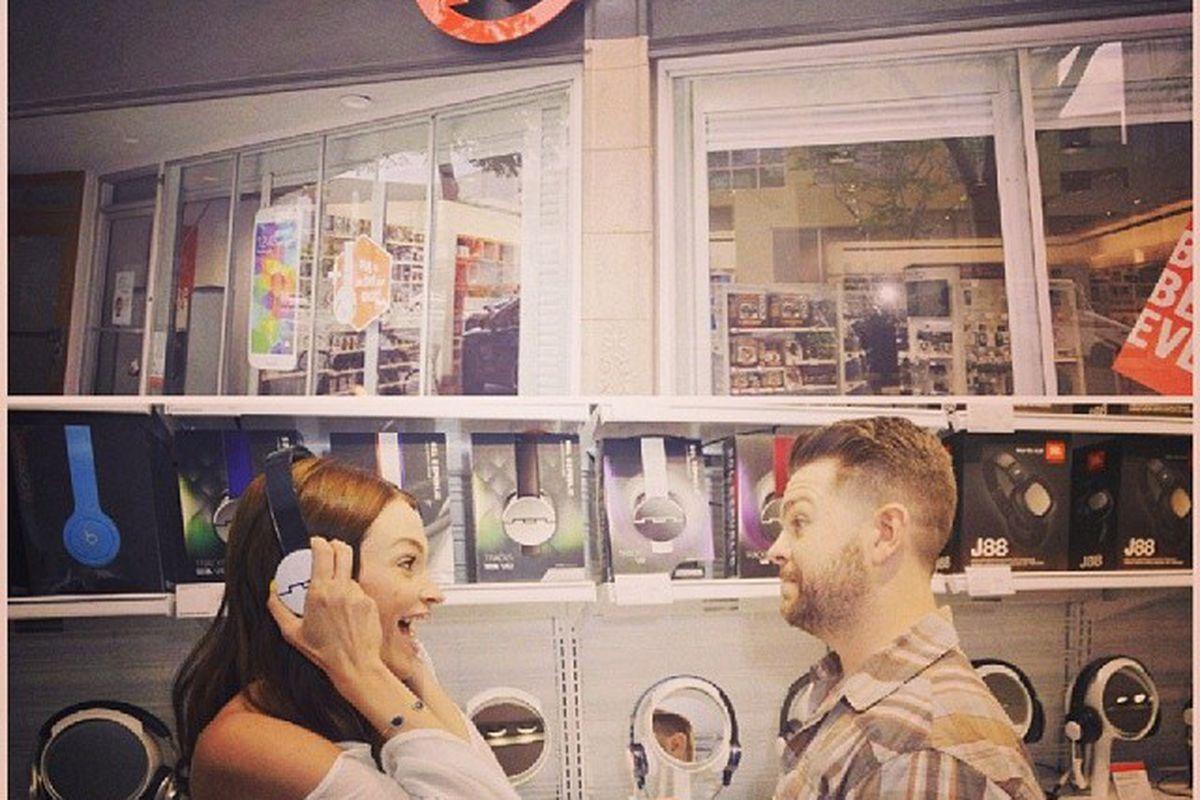 "Jack and Lisa Osbourne check out the new features at RadioShack; photo via RadioShack/<a href=""http://instagram.com/radioshack"">Instagram</a>"