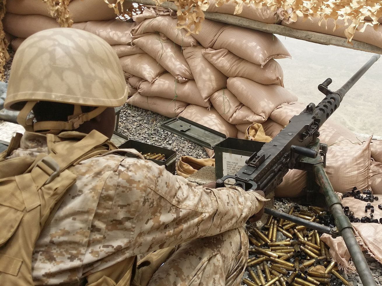 A Saudi soldier on the lookout while patrolling at the Saudi-Yemeni border on April 13, 2015, in Saudi Arabia.