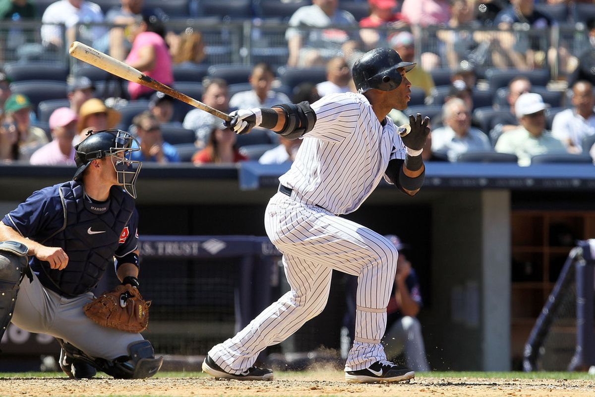 NEW YORK, NY - JUNE 27:  Robinson Cano #24 of the New York Yankees hits a sixth inning two run home run against the Cleveland Indians at Yankee Stadium on June 27, 2012  in the Bronx borough of New York City.  (Photo by Jim McIsaac/Getty Images)