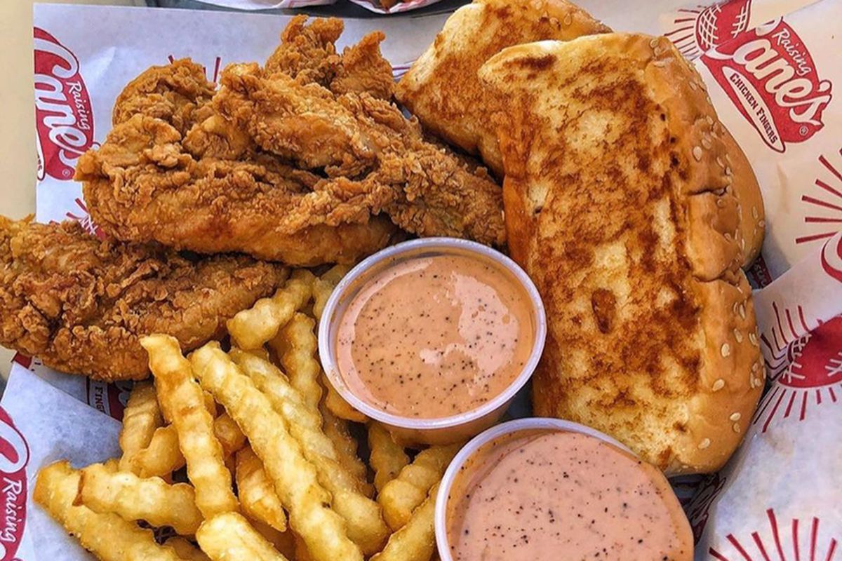 The Caniac combo at Raising Cane's, featuring chicken fingers, crinkle-cut fries, Cane's sauce, Texas toast and coleslaw.