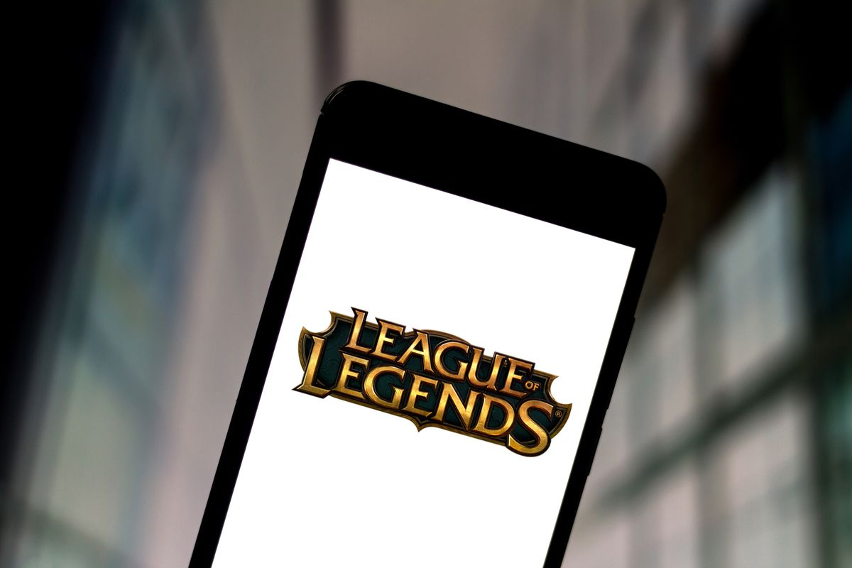 In this photo illustration a League of Legends logo seen...