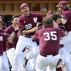 Mississippi State Bulldogs players celebrate their trip to the College World Series.