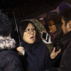 A Chinatown resident who asked to only be identified as Dorothy yells about public safety at Ald. Byron Sigcho-Lopez (25th) as hundreds gather for a vigil in a parking lot in the 2000 block of South Wells, where Huayi Bian and Weizhong Xiong were shot to death, Wednesday, Feb. 12, 2020. Bian and Xiong were killed during an apparent robbery, for which Alvin Thomas faces two counts of first-degree murder.