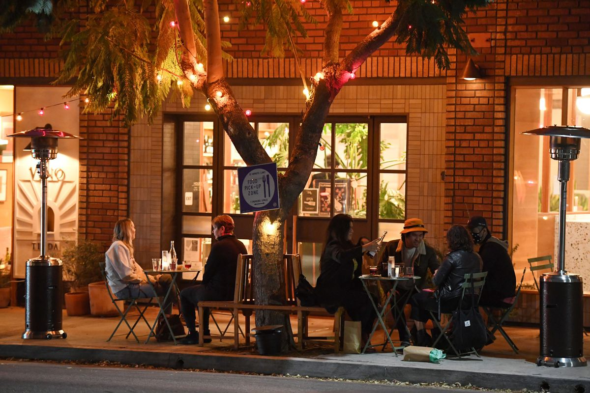 People eating outside a restaurant in Angeles on November 12.