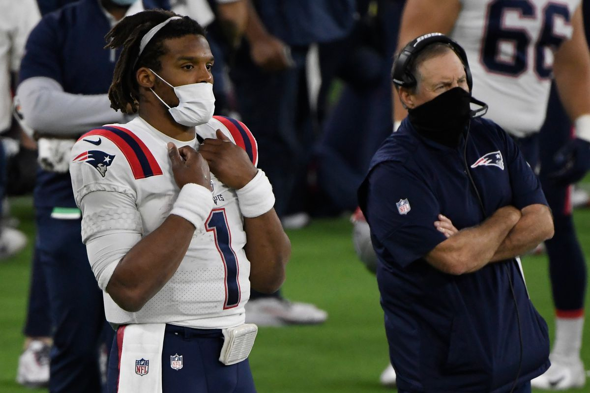 New England Patriots quarterback Cam Newton (1) looks on from the sidelines with head coach Bill Belichick after being replaced in the fourth quarter against the Los Angeles Rams at SoFi Stadium.
