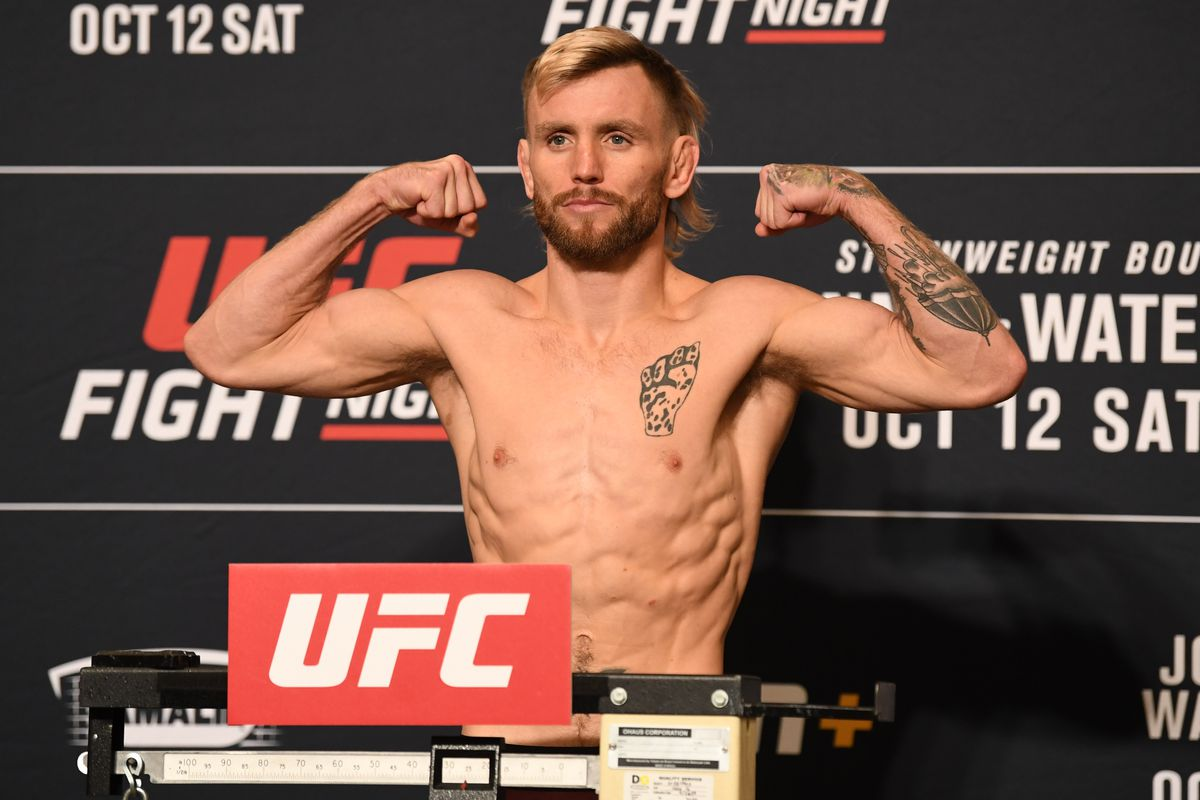 Tim Elliott poses on the scale during the UFC Fight Night weigh-in at the Westin Tampa Waterside on October 11, 2019 in Tampa, Florida.