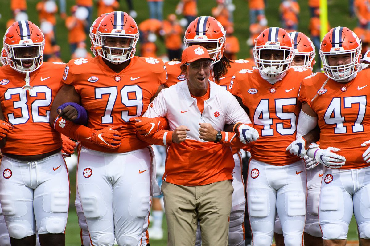 Clemson head coach Dabo Swinney walks with his players during the walk of champions before their game against The Citadel on Saturday, Sept. 19, 2020.