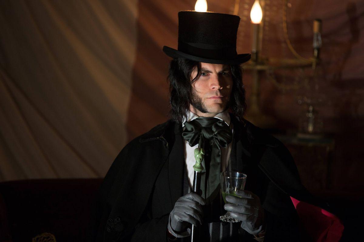 a dark haired man in victorian garb
