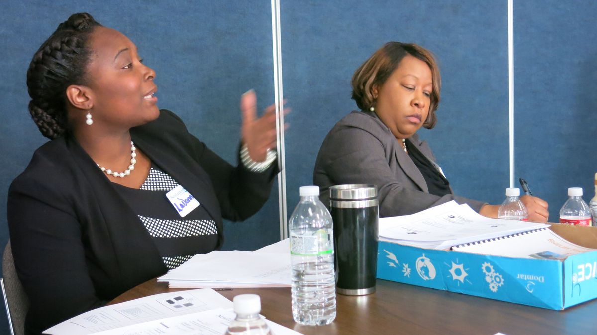 LaDonna Braswell, left, offers feedback on another aspiring principal's plan.