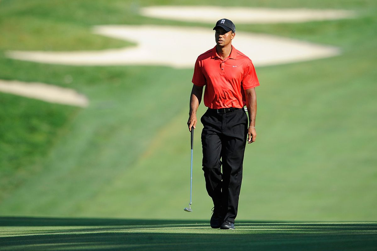 BETHESDA, MD - JULY 01:  Tiger Woods walks up the fairway on the 15th hole during the Final Round of the AT&T National at Congressional Country Club on July 1, 2012 in Bethesda, Maryland.  (Photo by Patrick McDermott/Getty Images)