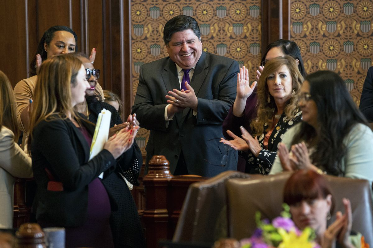 Gov. J.B. Pritzker cheers as Senate President John Cullerton, D-Chicago, gives his final remarks on the floor of the Illinois Senate during overtime of the Spring Session at the Illinois State Capitol, on June 2, 2019, in Springfield, Ill.