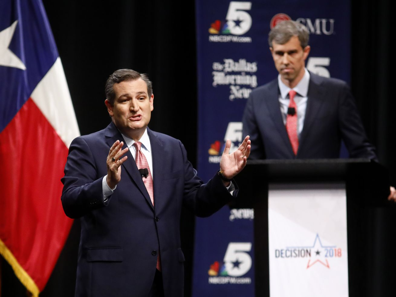 Sen. Ted Cruz makes his final remarks as Rep. Beto O'Rourke looks on during a debate in Dallas, Texas in September 2018.
