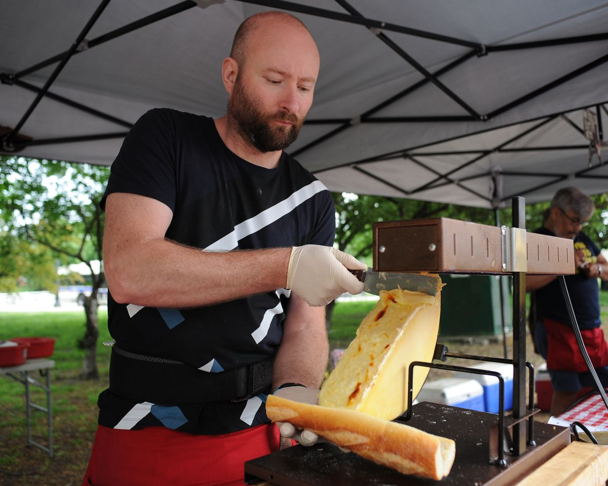 Luis Soto from Baked Cheese Haus making a grill cheese sandwich at the Green City Market in Lincoln Park.   Victor Hilitski/For the Sun-Times
