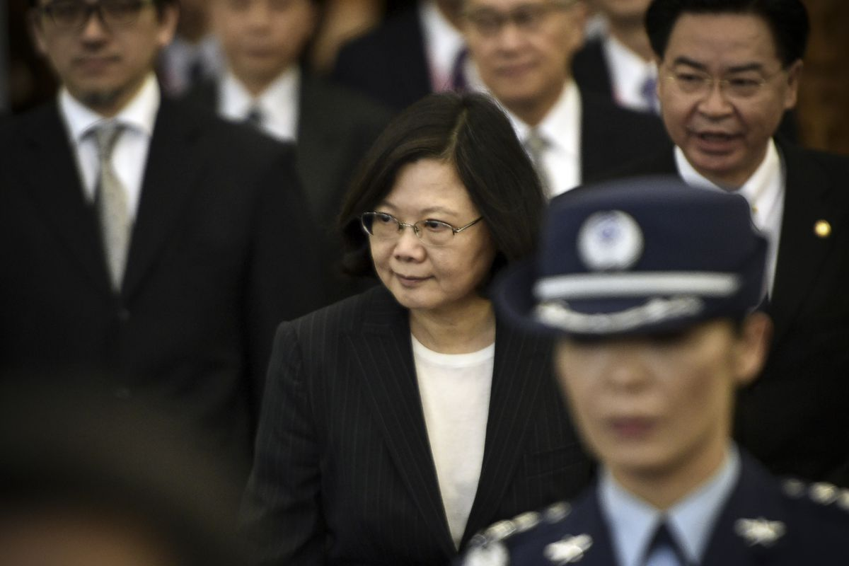Taiwan's President Tsai Ing-wen (center) is escorted by security staff before departing from Taoyuan airport on January 7, 2017. Tsai Ing-wen left for the US on her way to Central America, a trip that was closely watched by Beijing, which was incense