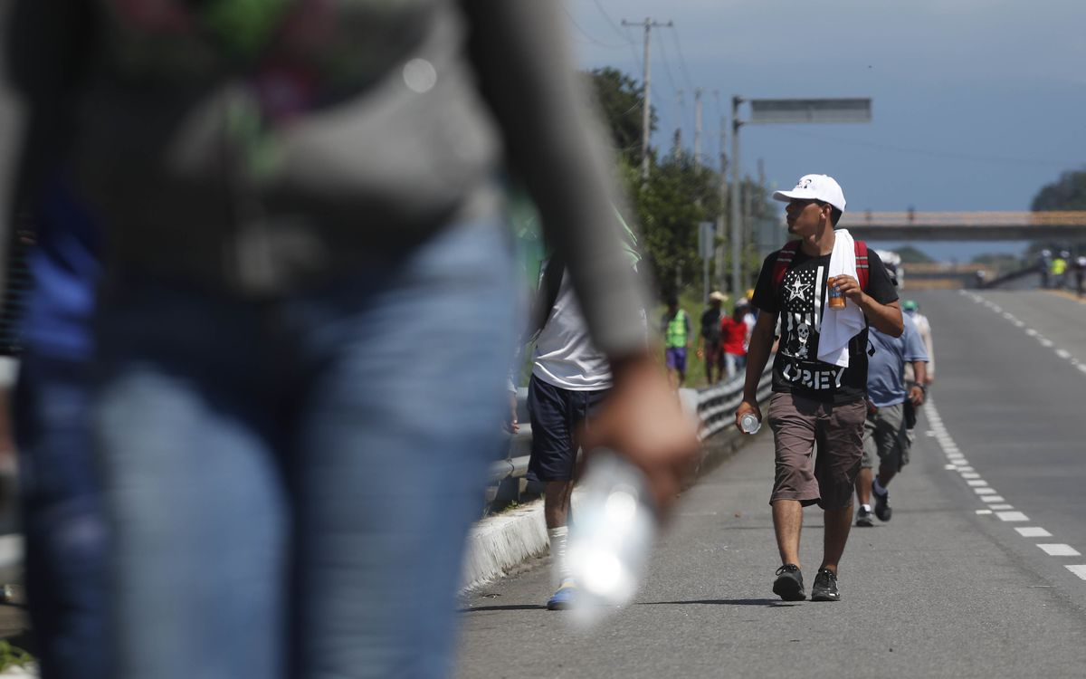 Central American migrants making their way to the U.S. arrive by foot to Tapachula, Mexico, Sunday, Oct. 21, 2018. Despite Mexican efforts to stop them at the Guatemala-Mexico border, about 5,000 Central American migrants resumed their advance toward the