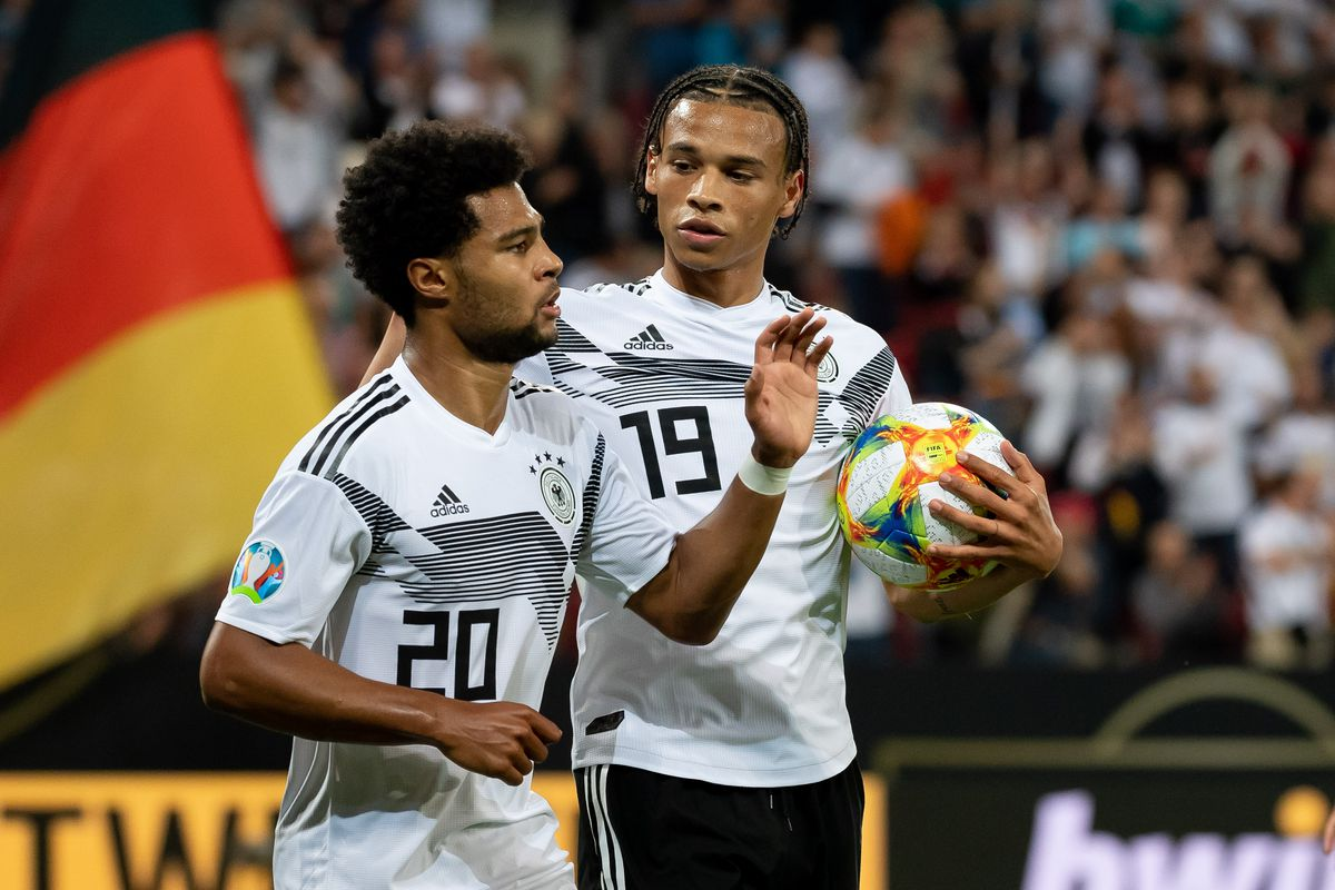 MAINZ, GERMANY - JUNE 11: Serge Gnabry of Germany celebrates after scoring his team's sixth goal with Leroy Sane of Germany during the UEFA Euro 2020 Qualifier match between Germany and Estonia at Opel Arena on June 11, 2019 in Mainz, Germany.