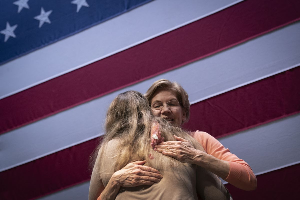 Senator Elizabeth Warren hugging a supporter.