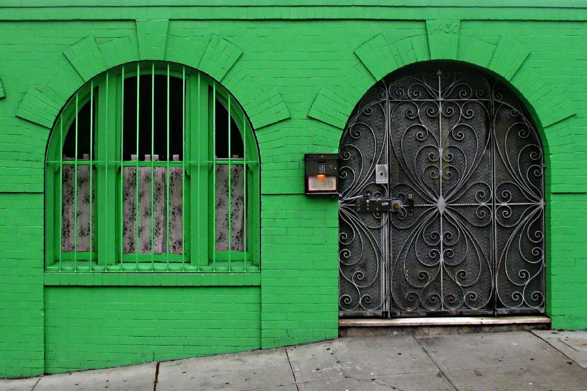Green facade of apartment building.