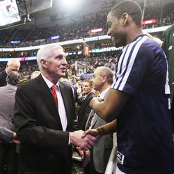 Alec Burks shakes hands with former Utah Jazz coach Jerry Sloan after having his banner unveiled in his honor during halftime of the Utah Jazz game in Salt Lake City Friday, Jan. 31, 2014.