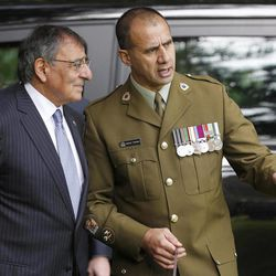 U.S. Defense Secretary Leon Panetta, left, talks to New Zealand Maori Cultural Advisor WO1 Jerald Twomey during an official welcoming ceremony at the Government House in Auckland, New Zealand Friday, Sept. 21, 2012. Panetta become the first Pentagon chief to visit the South Pacific nation in 30 years as the U.S. tries to rebuild military ties that were fractured when New Zealand banned nuclear warships from its shores.