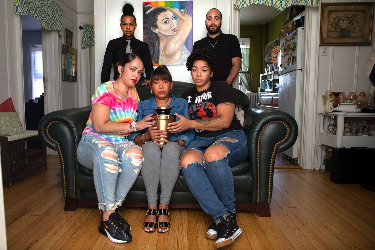 Layleen Polanco's family and friends — clockwise: brother Saloman Polanco; best friend Ramon Monclus; sister Melania Brown; mother Aracelis Polanco; and best friend Amanda Collaszo — hold her ashes at her Yonkers family home, Aug. 5, 2019