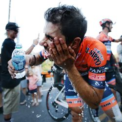 Marco Canola of team Nippo-Vini Fantini-Faizane washes his face off with water after winning Stage 4 of the Tour of Utah in Salt Lake City on Friday, Aug. 16, 2019.