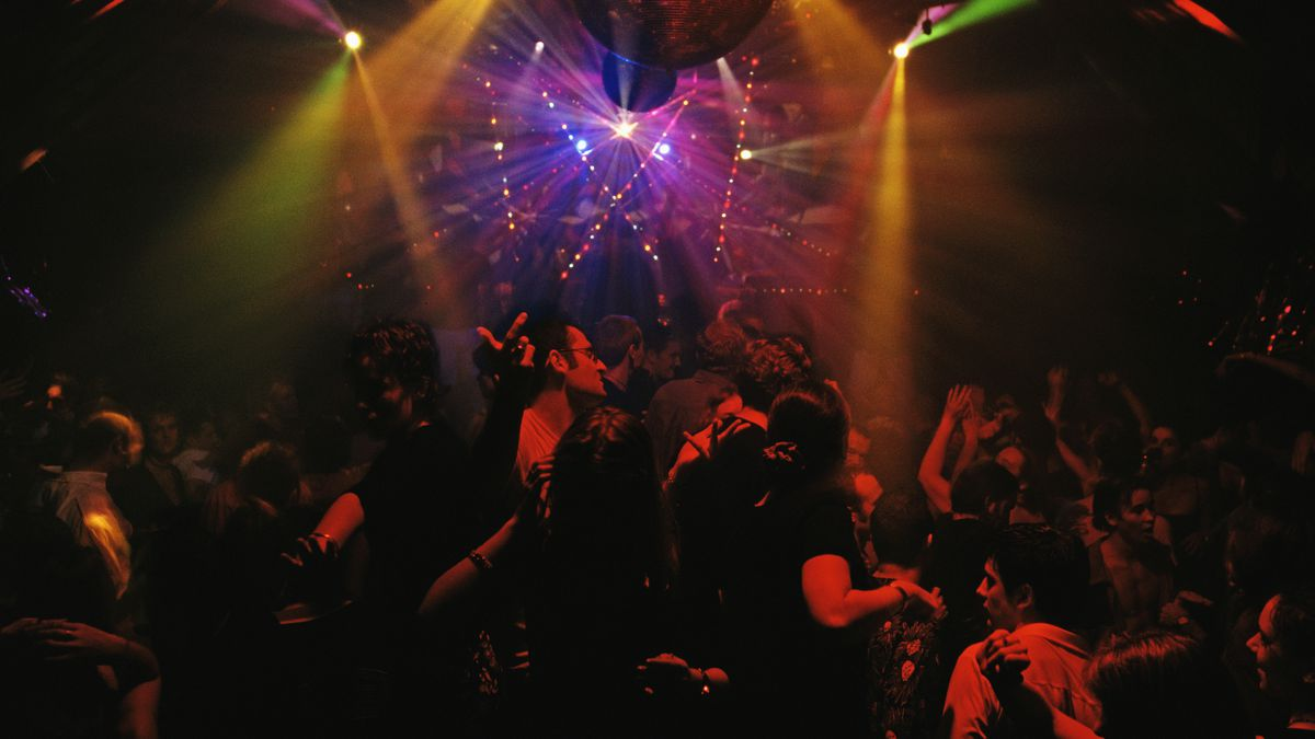 People dance in a London nightclub.