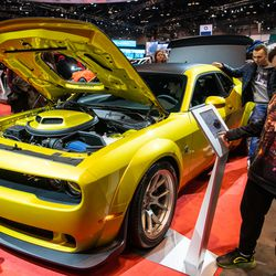 A young car enthusiast take a look at the 2020 Dodge Challenger at the 2020 Chicago Auto Show Saturday at McCormick Place.
