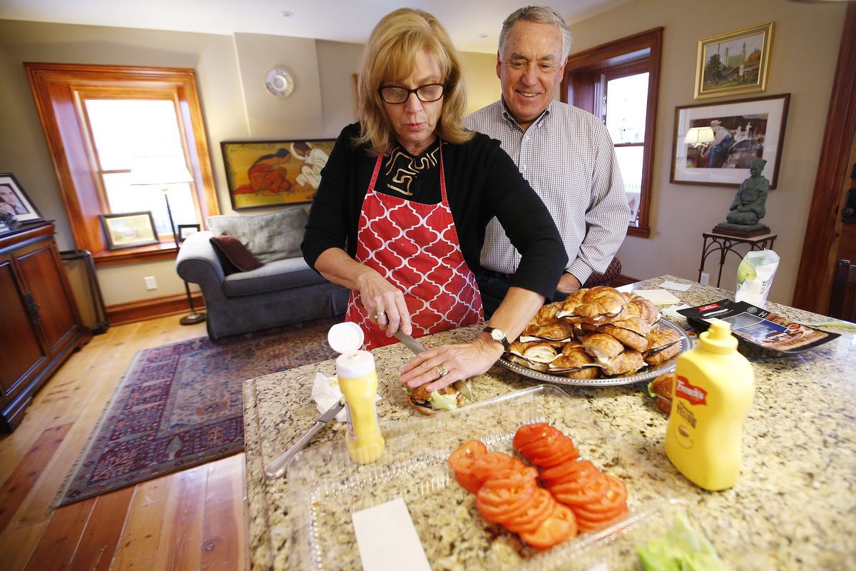 Chris and Alison Anderson make sandwiches for a meeting in their home in Spring City on Sunday, Nov. 5, 2017. They are from opposing political parties. Chris is running for city council.